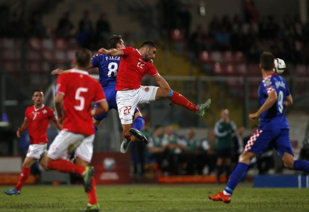 Malta's Zach Muscat (centre) and Croatia's Marko Pjaca (3rd L) challenge for a high ball during their Euro 2016 Group H qualification soccer match at the National Stadium in Ta' Qali on October 13. Photo: Darrin Zammit Lupi