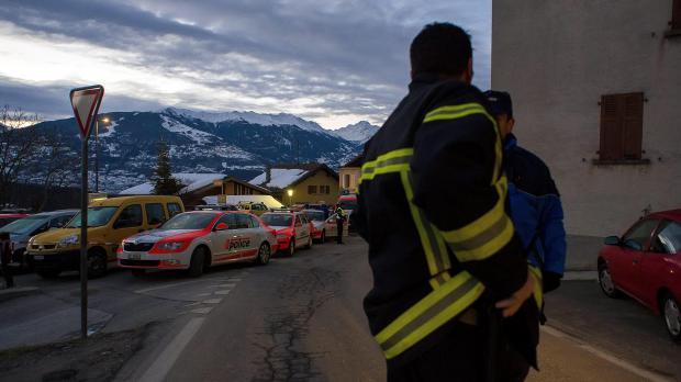 Police patrol in the village of Daillon after a shooting, in Switzerland, early today.  Photo: Keystone, Olivier Maire