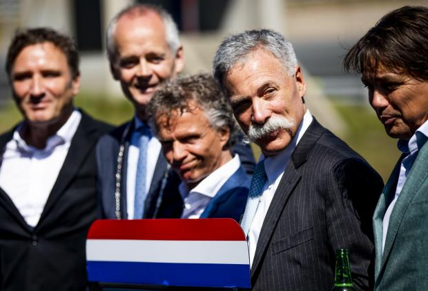 Sporting director Jan Lammers, Chase Carey of the Formula One Group and others pose as they sign an agreement that confirms the advent in May 2020 of the Grand Prix.