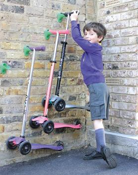 Danielle Vella's son, Frank Izzo, aged five, hanging up a scooter at his school in Wimbledon, UK.