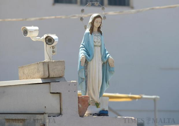 Security cameras and a statue of Our Lady protect a shop in San Gwann on June 23. Photo: Matthew Mirabelli
