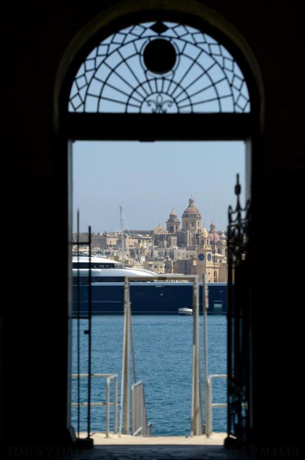 A super yacht is seen through the doorway of Customs house, Valletta on June 2. Photo: Matthew Mirabelli