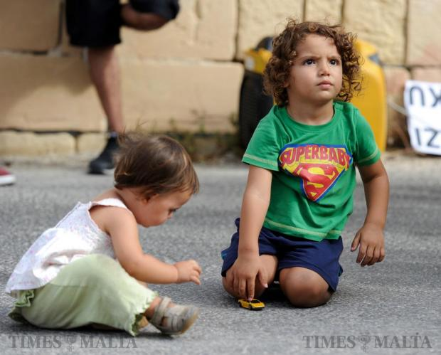 Two children play together at Manoel Island on September 17. Photo: Steve Zammit Lupi