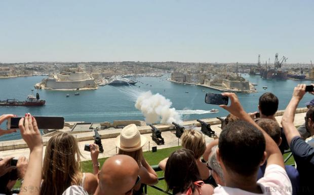 Tourists gather at the Upper Barrakka Gardens to witness the firing of the noonday gun on June 10. Photo: Chris Sant Fournier