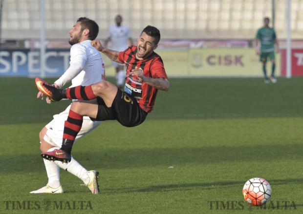 Hamrun Spartans FC player Luke Sciberras (right) is fouled by Valletta FC player Ryan Camilleri in a football match held at the National stadium in Ta' Qali on February 12. Photo: Mark Zammit Cordina