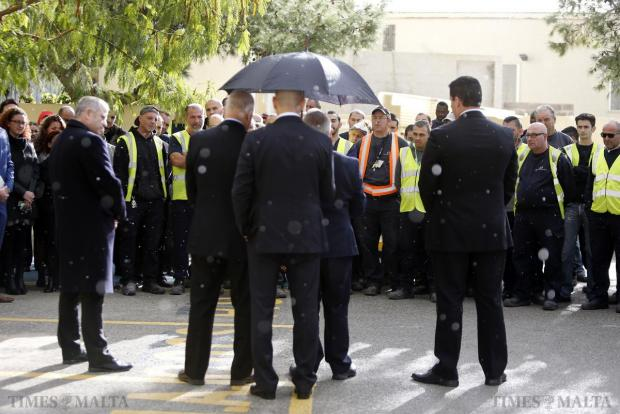 Environment Minister Leo Brincat shelters under an umbrella from a light rain shower as he addresses Wasteserv employees at the recycling plant in Marsascala on December 29. Photo: Darrin Zammit Lupi