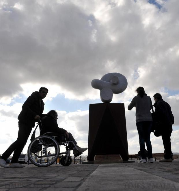 Tourists walk past the migration monument at Castille Place in Valletta on December 30. Photo: Chris Sant Fournier