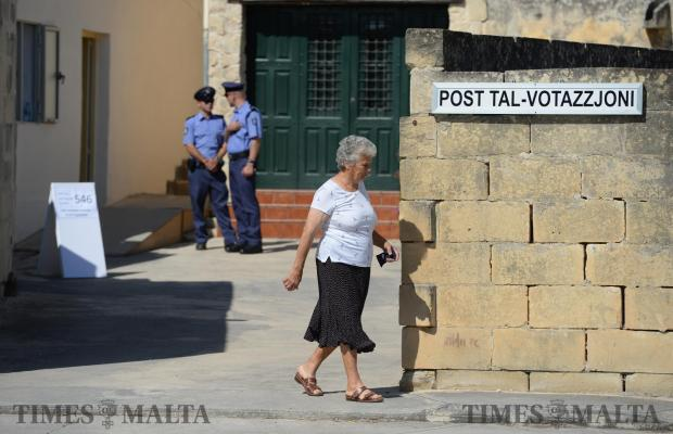 A women exits a voting station in Burmaradd on June 3. Photo: Matthew Mirabelli