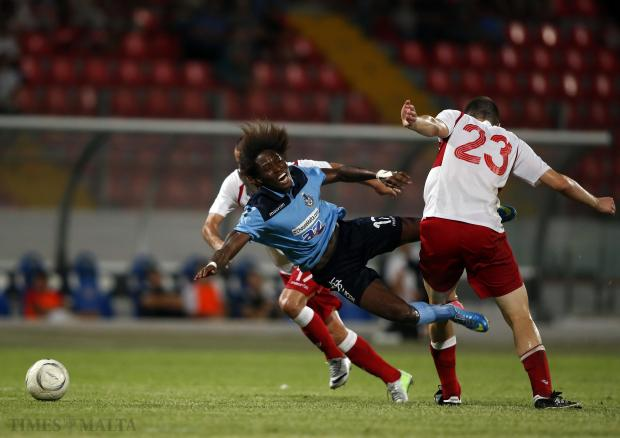 Sliema Wanderers forward Pape Gueye is sent tumbling after being challenged during his side's 2-0 win over Naxxar Lions at the National Stadium on August 31. Photo: Darrin Zammit Lupi