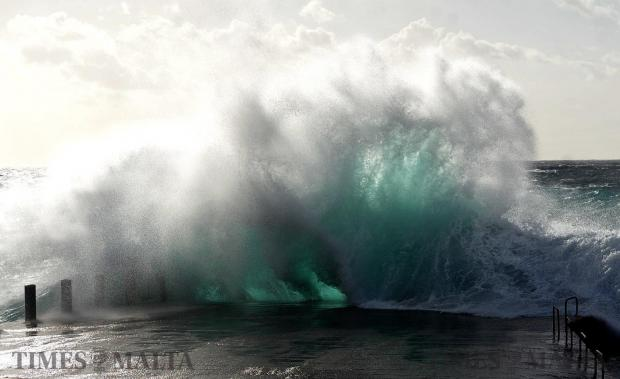 A wave crashes against the quay in Cirkewwa on February 6. Photo: Chris Sant Fournier