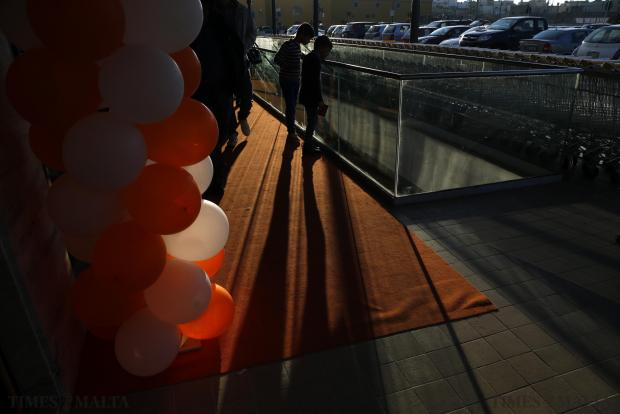 Two boys look down into a ramp leading to an underground garage at a shopping mall in Mosta on December 8. Photo: Darrin Zammit Lupi
