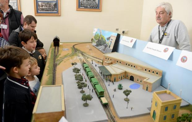 Children and adults alike admire a model train as it passes through a replica of the Hamrun train station during an exhibition at the same locality on January 28. Photo: Matthew Mirabelli
