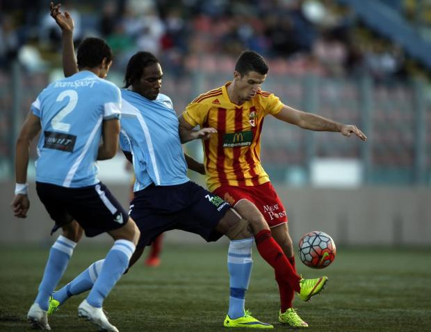 Birkirkara's Vito Plut (right) defends possession of the ball from Naxxar Lions' Moises Gnenegbe during their Premier League football match at the Tedesco Stadium in Hamrun on November 21. Photo: Darrin Zammit Lupi