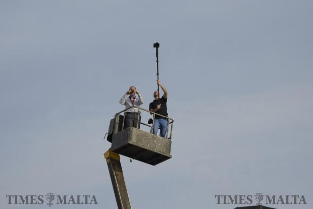 A photographer lifts his camera on a monopod from a cherry picker during a meeting held by the Labour party in Zabbar on May 7. Photo: Mark Zammit Cordina