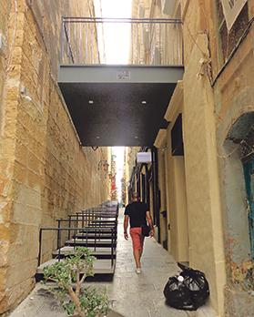 An 'outside stage' on a recently installed balcony in Strait Street extends to within a few inches of the opposite wall, altering the fabric of the historic walled city of Valletta and setting an alarming precedent. Photo: Anne Zammit