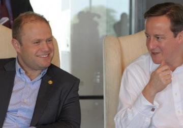 Dr Muscat with Brithsh PM Cameron at the casual retreat during the current CHOGM.