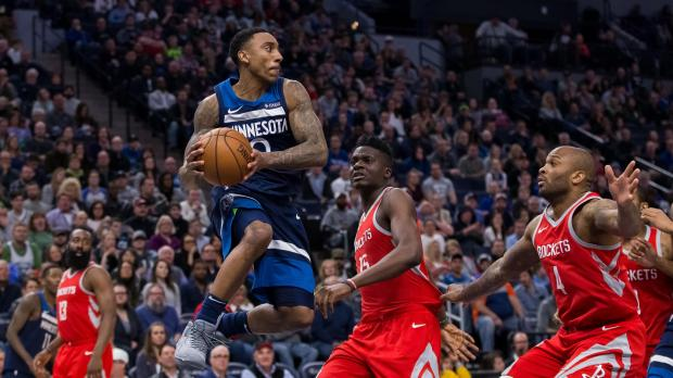Minnesota Timberwolves guard Jeff Teague (0) passes in the fourth quarter against Houston Rockets at Target Center. Photo Credit: Brad Rempel-USA TODAY Sports