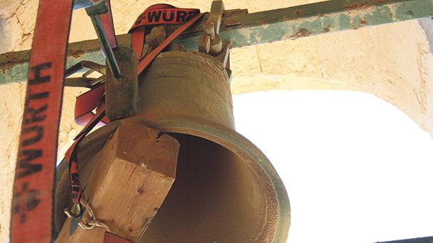 The old bell being removed from the belfry.