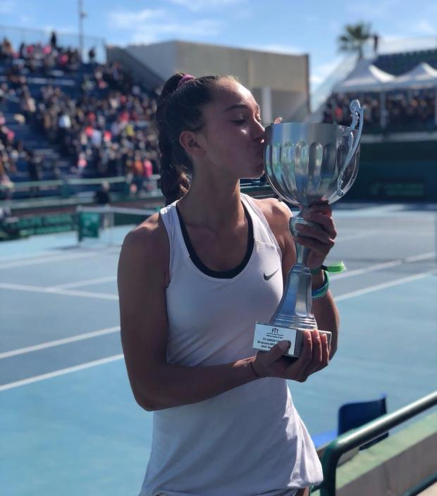 Francesca Curmi kissing the trophy after her victory in Tunisia.