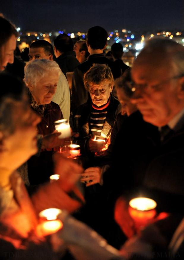 People hold candles at the candle light vigil organised by the Life Network foundation to reinforce what it described as Malta's traditional and time-honoured values, in Valletta on December 3. Photo: Chris Sant Fournier