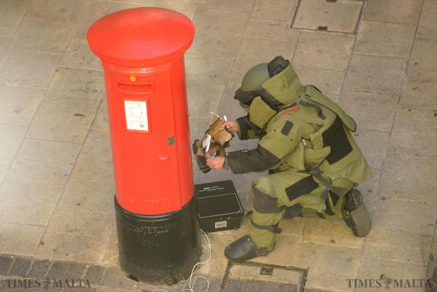 A member of the Bomb Disposal Unit opens a suspicous package which was left next to a post box near St John's Cathedral in Republic Street, Valletta on January 5. Photo: Matthew Mirabelli