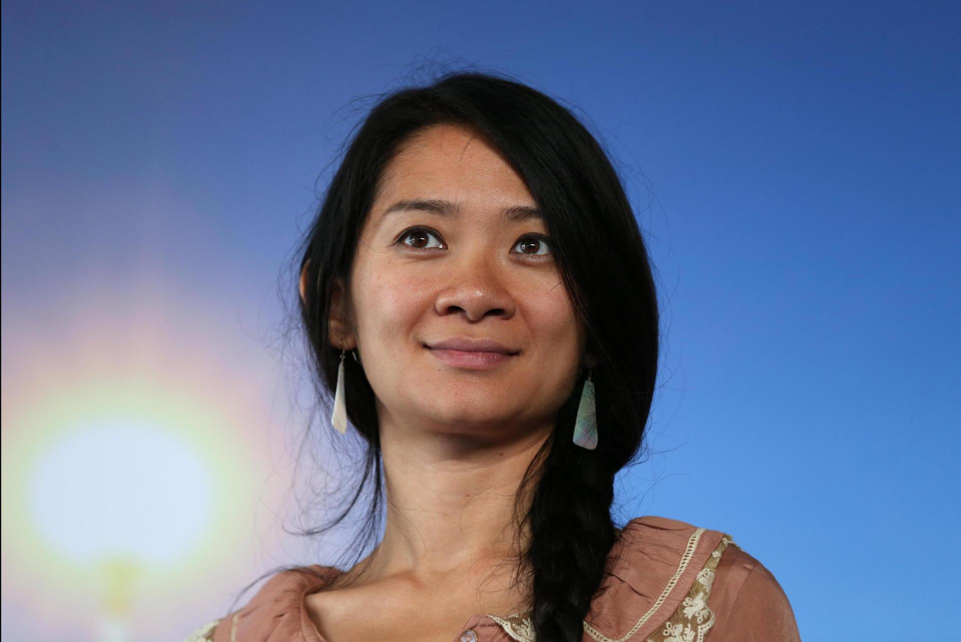 Chloe Zhao became the first female director to win the awards' top prize for best drama. Photo: Charly Triballeau/AFP