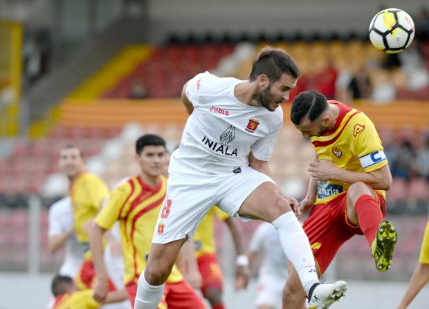 Valletta's Santiago Malano, (left) beats Senglea's Terrence Vella to the ball during their Premier league match at the Hibernian's Stadium in Paola on January 6. Photo: Matthew Mirabelli
