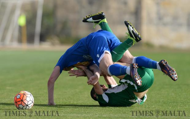 Two players collide as Mosta take on Floriana in the BOV Premiership at the Hibernians Stadium in Kordin on April 29. Photo: Matthew Mirabelli