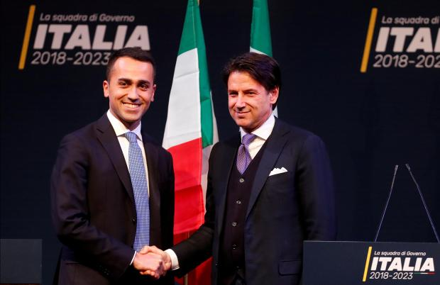 File photo: 5-Star Movement leader Di Maio shakes hands with Giuseppe Conte.