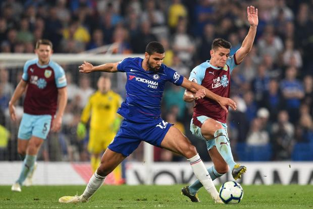 Burnley's English midfielder Ashley Westwood (right) vies with Chelsea's English midfielder Ruben Loftus-Cheek.