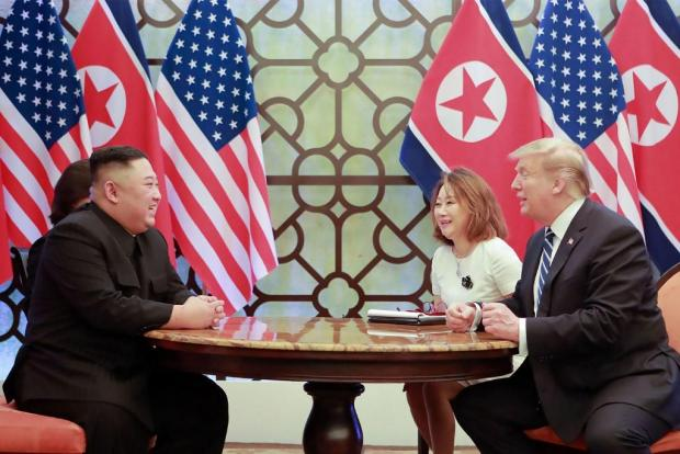 This picture released on March 1 shows North Korean leader Kim Jong Un (L) meeting with US President Donald Trump.