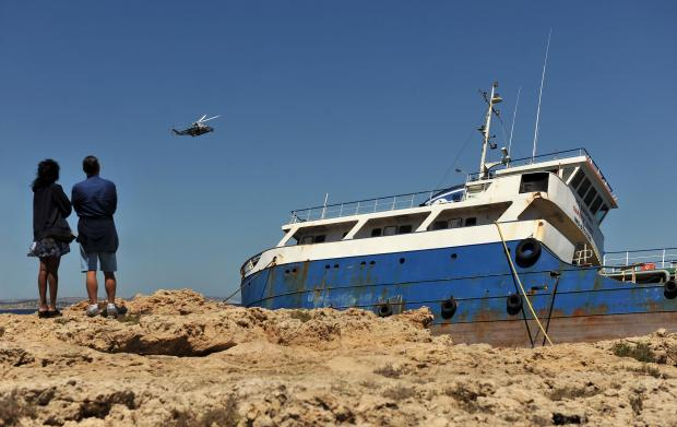An AFM helicopter passes low by the stricken tanker Hephaestus which was shipwrecked on February 10. The Tanker has since become an attraction in Qawra on May 7. Photo: Chris Sant Fournier
