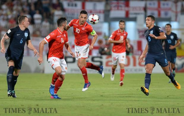 Malta's Andre Schembri (no 10) heads the ball to Jean Paul Farrugia during their FIFA 2018 World cup Qualifying Group F Match against England at the National Stadium in Ta'Qali on September 1. Photo: Matthew Mirabelli