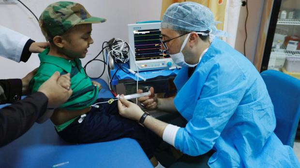 A child gets a chemotherapy injection at the Misurata Cancer Centre.