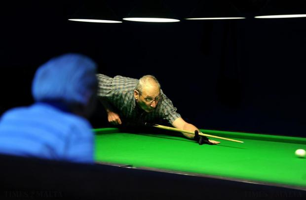 A snooker player takes a shot at the La Vallette band club on October 22. Photo: Chris Sant Fournier
