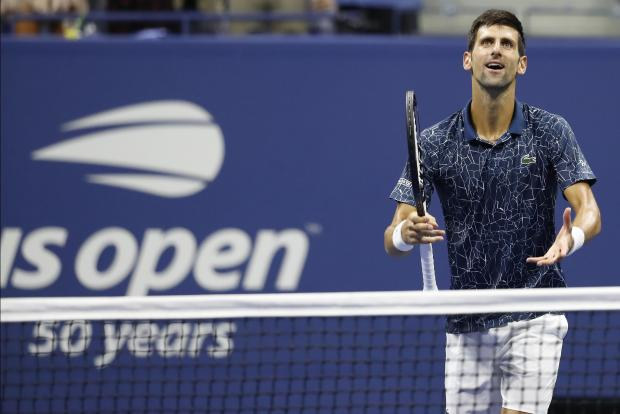 Novak Djokovic of Serbia gestures to the crowd after his match against Kei Nishikori of Japan (not pictured) in a men's semi-final match on day twelve of the 2018 U.S. Open tennis tournament at USTA Billie Jean King National Tennis Center. Mandatory Credit: Geoff Burke-USA TODAY Sports