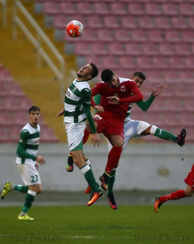 Valletta's Luke Montebello (centre) is challenged by Floriana's Clyde Borg and Steve Pisani during their Premier League football match at the National Stadium in Ta'Qali on December 17. Photo: Darrin Zammit Lupi