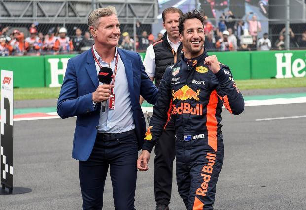 Daniel Ricciardo (right) celebrates his pole with David Coulthard.