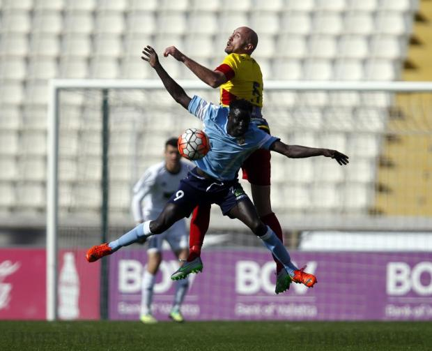 Naxxar Lions' Demba Toure (front) and Birkirkara's Mauricio Mazzetti challenge for a high ball during their Premier League football match at the National Stadium in Ta'Qali on March 20. Photo: Darrin Zammit Lupi