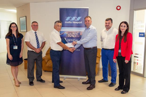 Malta Freeport Terminals CEO Alex Montebello (third from right) hands over the sponsorship to Birzebbuga Aquatic & Sports Club president George Farrugia.