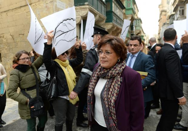 Portuguese MEP Ana Gomes walks by activists who gathered outside Dar l-Ewropa in Valletta on December 1, calling for respect for the rule of law. Ms Gomes led a two-day fact-finding mission in Malta. Photo: Matthew Mirabelli