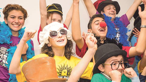 Children participating in the Helen O'Grady Academy programme taking part in a theatrical performance at the school.