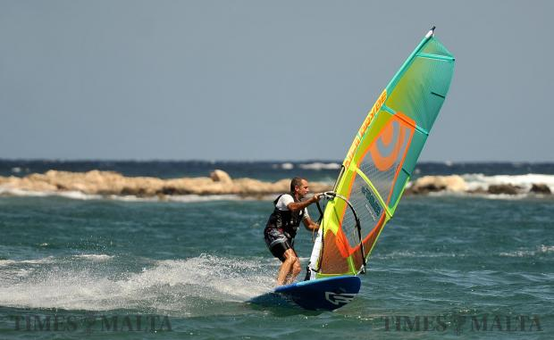 A windsurfer carves into a gybe at Ghallis on September 3. Photo: Chris Sant Fournier