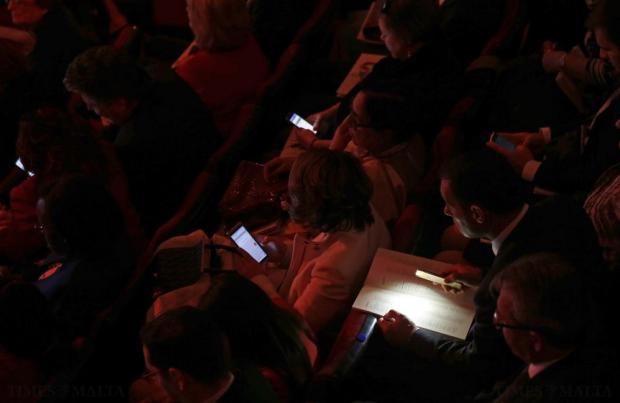 Guests check their mobile devices as they wait for the start of the opening ceremony of the Commonwealth Heads of Government Meeting (CHOGM) in Valletta on November 27. Photo: Darrin Zammit Lupi