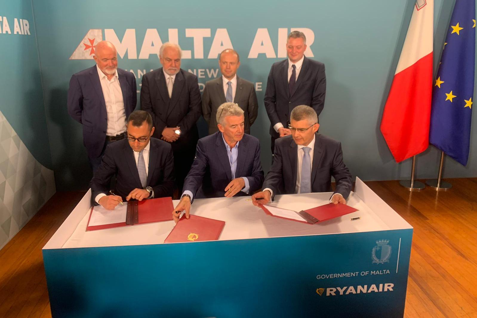 Top government officials including Prime Minister Joseph Muscat look on as Ryanair and the Maltese government seal the deal to create Malta Air. Photo: Ivan Martin