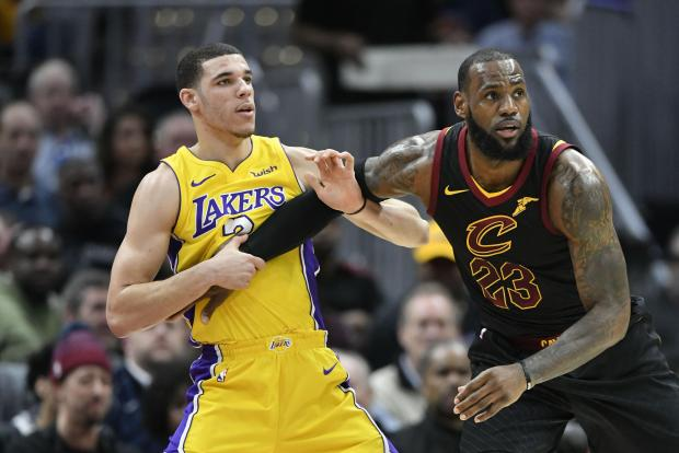 s Angeles Lakers guard Lonzo Ball (2) defends Cleveland Cavaliers forward LeBron James (23) in the first quarter at Quicken Loans Arena. Photo: David Richard-USA TODAY Sports