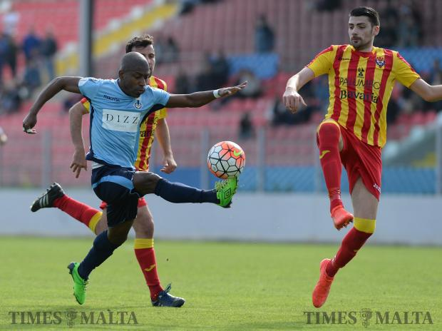 Sliema's Demi Dos Santos (left) makes his way past Senglea's Mark Borg during their FA Trophy match at Hibernians Stadium in Paola on February 18. Photo: Matthew Mirabelli