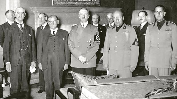 British Prime Minister Neville Chamberlain, French Prime Minister Édouard Daladier, German Chancellor Adolf Hitler, Italian Prime Minister Benito Mussolini and Italian Foreign Minister Gian Galeazzo Ciano before signing the Munich Agreement at about 1.30am on September 30, 1938.