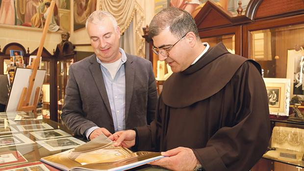 Fr Firas Lutfi and Stephen Axisa viewing exhibits at Ta' Pinu Santuary. Photos: Charles Spiteri