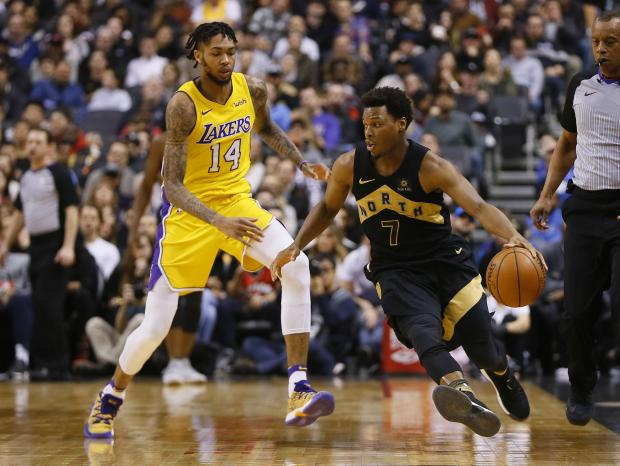 Toronto Raptors guard Kyle Lowry (7) tries to get around Los Angeles Lakers forward Brandon Ingram (14) during the first half at the Air Canada Centre. Photo: John E. Sokolowski-USA TODAY Sports